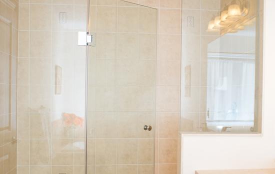 Frame-less glass shower stall in new bathroom