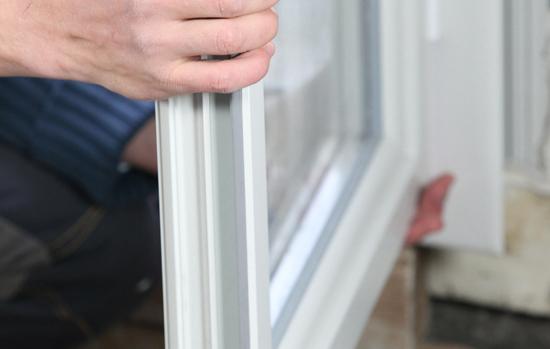 Man installing double glazed windows