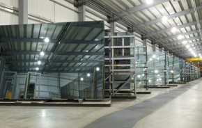 Large sheets of glass in a factory storage aera.